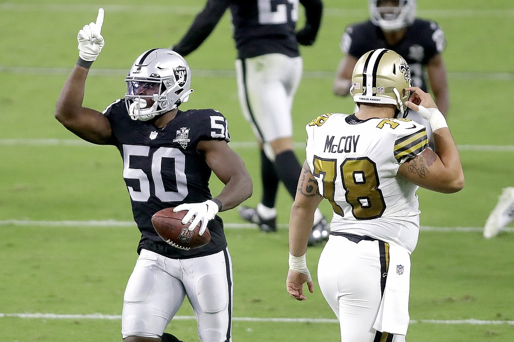 Las Vegas Raiders linebacker Nicholas Morrow (50) celebrates after making an interception against the New Orleans Saints during the first half of an NFL football game, Monday, Sept. 21, 2020, in Las Vegas. (AP Photo/Isaac Brekken)