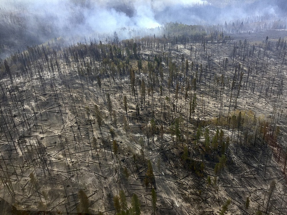In this aerial photo provided by the U.S. Forest Service, smoke from a wildfire is in part of Medicine Bow National Forest on Monday, Sept. 21, 2020. The fire burning since last Thursday, prompting an evacuation order for a 300-square-mile portion of the forest in southeastern Wyoming. (Jerod Delay/U.S. Forest Service via AP)