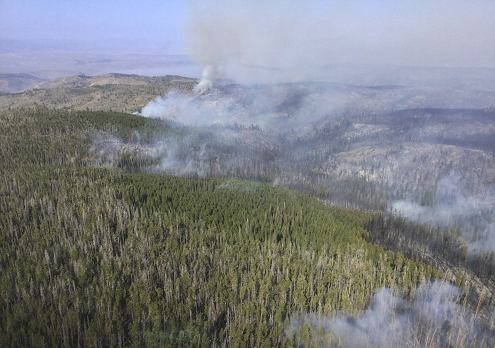 In this aerial photo provided by the U.S. Forest Service, smoke from a wildfire is in part of Medicine Bow National Forest on Monday, Sept. 21, 2020. The fire has been burning since last Thursday, prompting an evacuation order for a 300-square-mile portion of the forest in southeastern Wyoming. (Jerod Delay/U.S. Forest Service via AP)