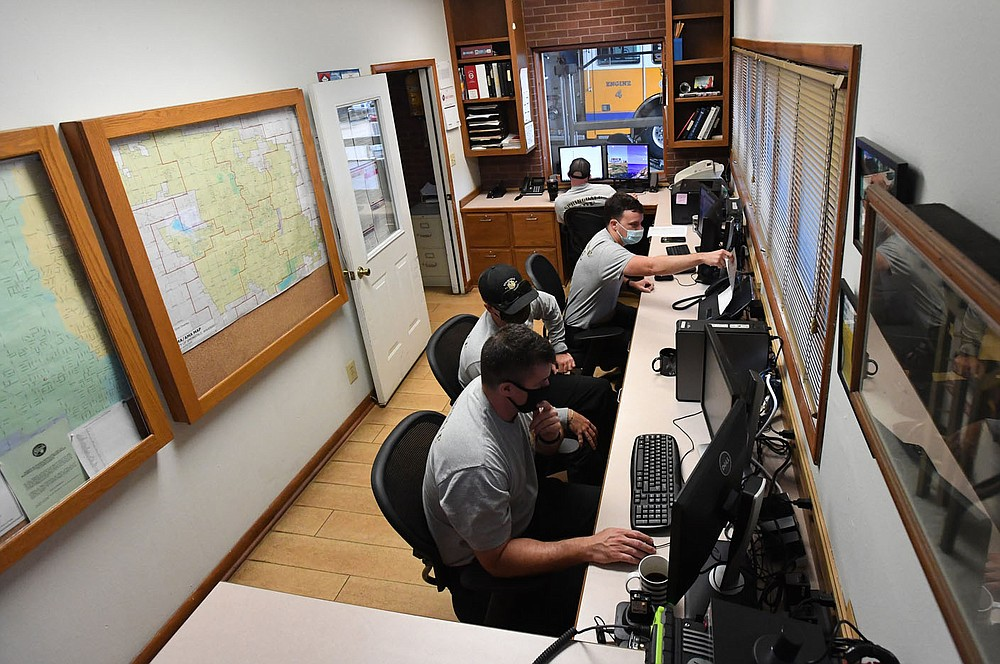 Springdale firefighters use a small room to work on computers for training and ongoing education Tuesday at Station No. 4. The Fire Department hopes to soon renovate the station. Go to nwaonline.com/200922Daily/ and nwadg.com/photos for a photo gallery. (NWA Democrat-Gazette/J.T. Wampler)