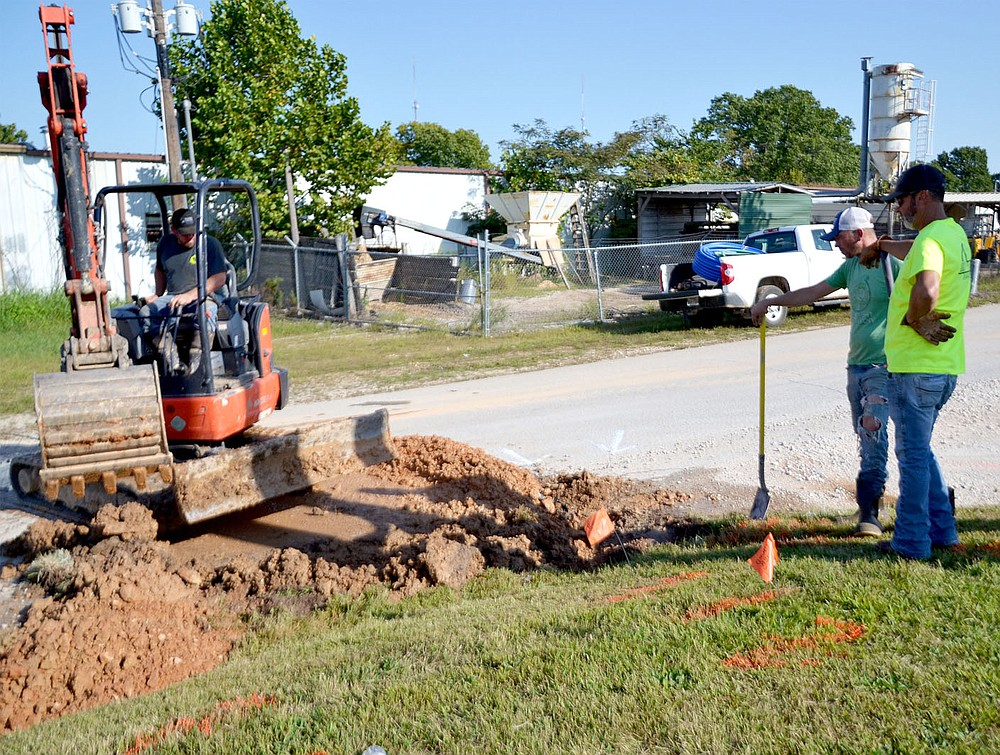 Garfield water employee Gary Wright, right, worked with contractors to repair a service line leak discovered Friday, Sept. 25, along the road east of Town Hall.