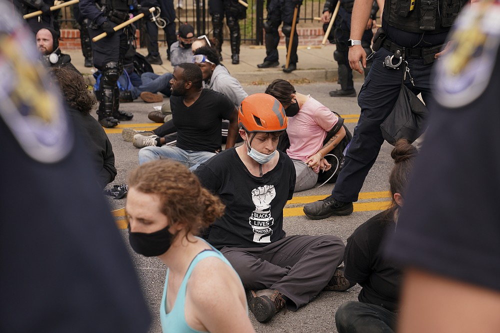 Police detain protesters, Wednesday, Sept. 23, 2020, in Louisville, Ky. A grand jury has indicted one officer on criminal charges six months after Breonna Taylor was fatally shot by police in Kentucky. The jury presented its decision against fired officer Brett Hankison Wednesday to a judge in Louisville, where the shooting took place. (AP Photo/John Minchillo)