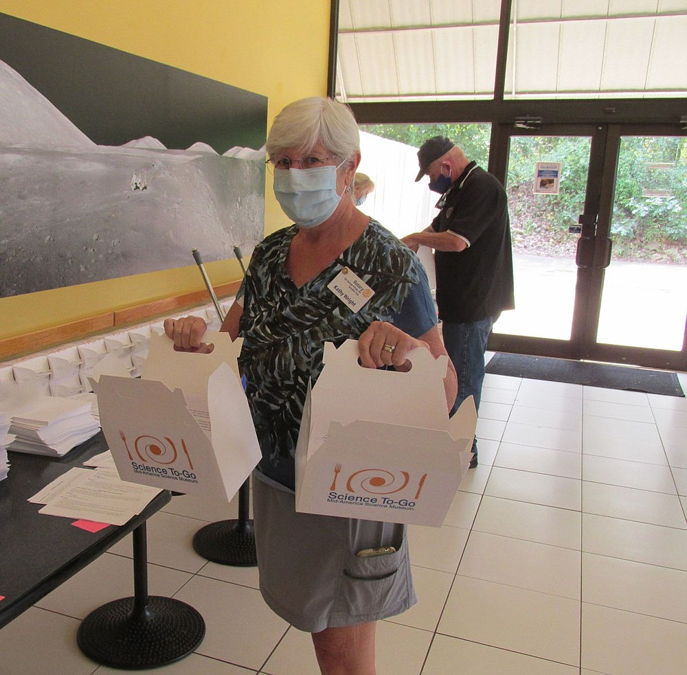 Rotarian Kathy Wright on the science kit assembly line. - Submitted photo
