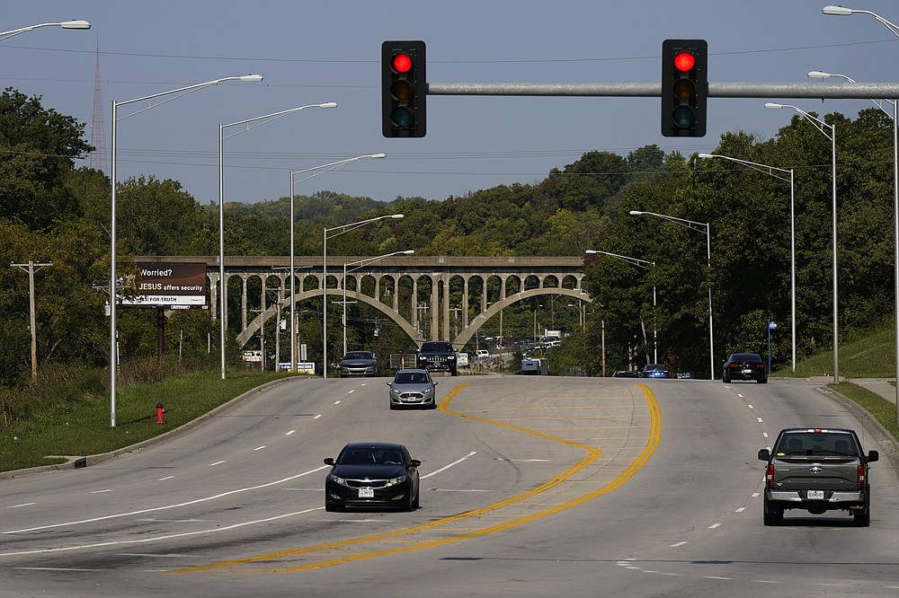 Cars travel under a landmark railroad viaduct on a stretch of Blue Parkway Thursday, Sept. 24, 2020, in Kansas City, Mo. The stretch of road, along with parts of two other streets, would be renamed to honor Rev. Martin Luther King Jr. under a city proposal coming in the wake of failed effort to honor King last year. (AP Photo/Charlie Riedel)