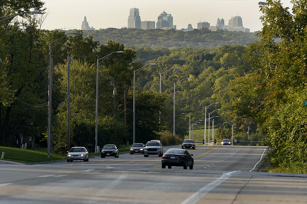 Cars travel on a stretch of Blue Parkway Thursday, Sept. 24, 2020, in Kansas City, Mo. The stretch of road, along with parts of two other streets, would be renamed to honor Rev. Martin Luther King Jr. under a city proposal coming in the wake of failed effort to honor King last year. (AP Photo/Charlie Riedel)
