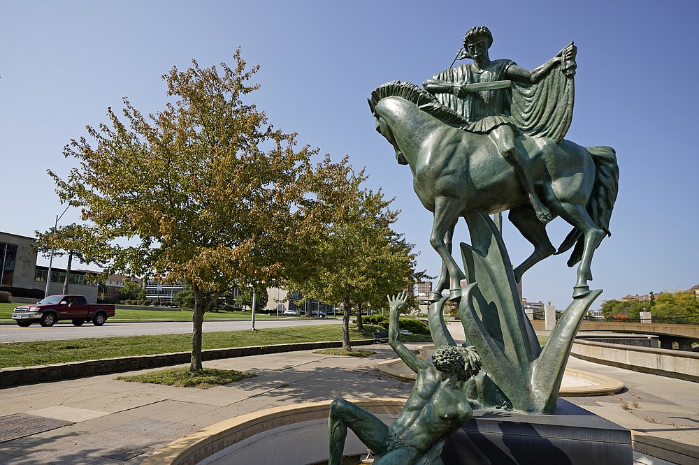 Statues rise from a fountain in a park adjacent to Volker Road Thursday, Sept. 24, 2020, in Kansas City, Mo. The stretch of road, along with parts of two other streets, would be renamed to honor Rev. Martin Luther King Jr. under a city proposal coming in the wake of failed effort to honor King last year. (AP Photo/Charlie Riedel)