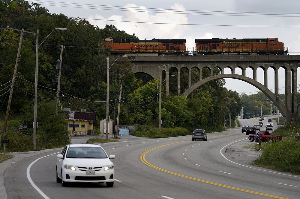 Cars travel under a landmark railroad viaduct on a stretch of Blue Parkway Tuesday, Sept. 22, 2020, in Kansas City, Mo. The stretch of road, along with parts of two other streets, would be renamed to honor Rev. Martin Luther King Jr. under a city proposal coming in the wake of failed effort to honor King last year. (AP Photo/Charlie Riedel)