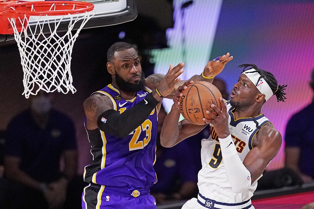 Denver Nuggets' Jerami Grant (9) drives against Los Angeles Lakers' LeBron James (23) during the second half of an NBA conference final playoff basketball game Saturday, Sept. 26, 2020, in Lake Buena Vista, Fla. (AP Photo/Mark J. Terrill)