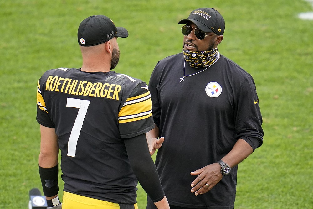 Pittsburgh Steelers head coach Mike Tomlin, right, talks with quarterback Ben Roethlisberger after a 28-21 win over the Houston Texans in an NFL football game in Pittsburgh, Sunday, Sept. 27, 2020. (AP Photo/Gene J. Puskar)