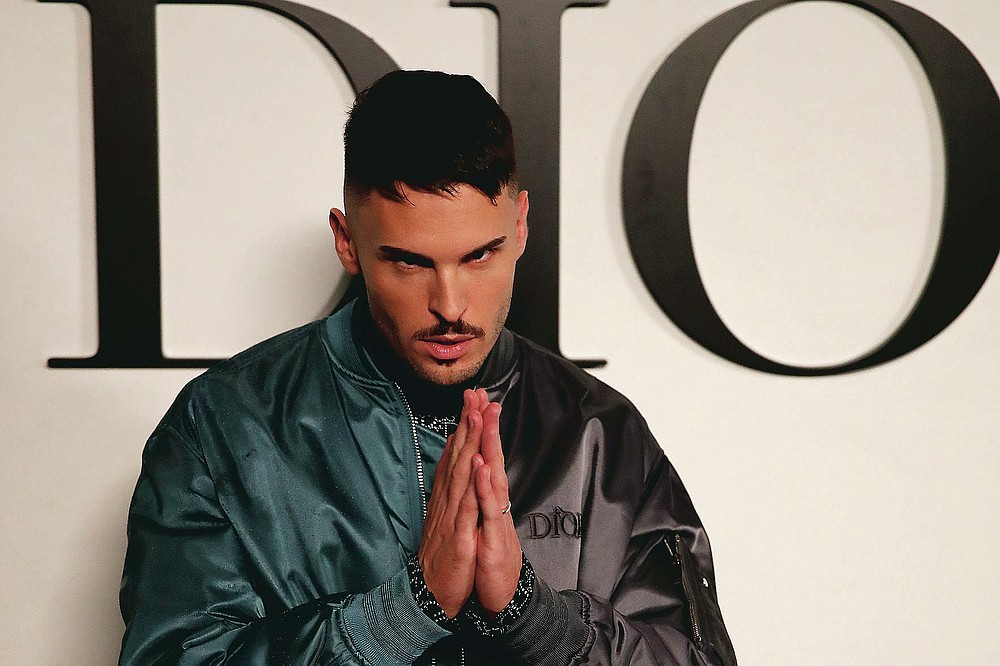 French model Baptiste Giabiconi poses before Dior's Spring-Summer 2021 fashion collection Tuesday, Sept. 29, 2020 before the show during the Paris fashion week. (AP Photo/Francois Mori)