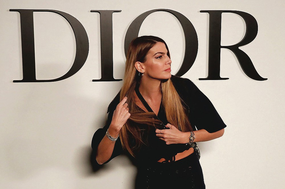 Italian actress Bianca Brandolini poses before Dior's Spring-Summer 2021 fashion collection Tuesday, Sept. 29, 2020 before the show during the Paris fashion week. (AP Photo/Francois Mori)