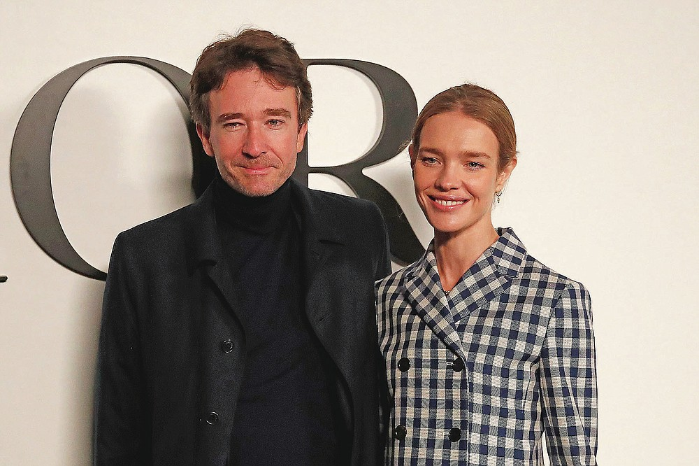 Natalia Vodianova and Antoine Arnault pose before Dior's Spring-Summer 2021 fashion collection Tuesday, Sept. 29, 2020 before the show during the Paris fashion week. (AP Photo/Francois Mori)