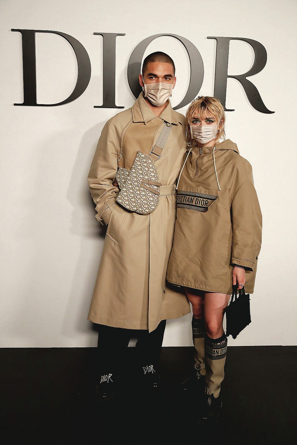 British actress Maisie Williams and Reuben Selby pose before Dior's Spring-Summer 2021 fashion collection Tuesday, Sept. 29, 2020 before the show during the Paris fashion week. (AP Photo/Francois Mori)