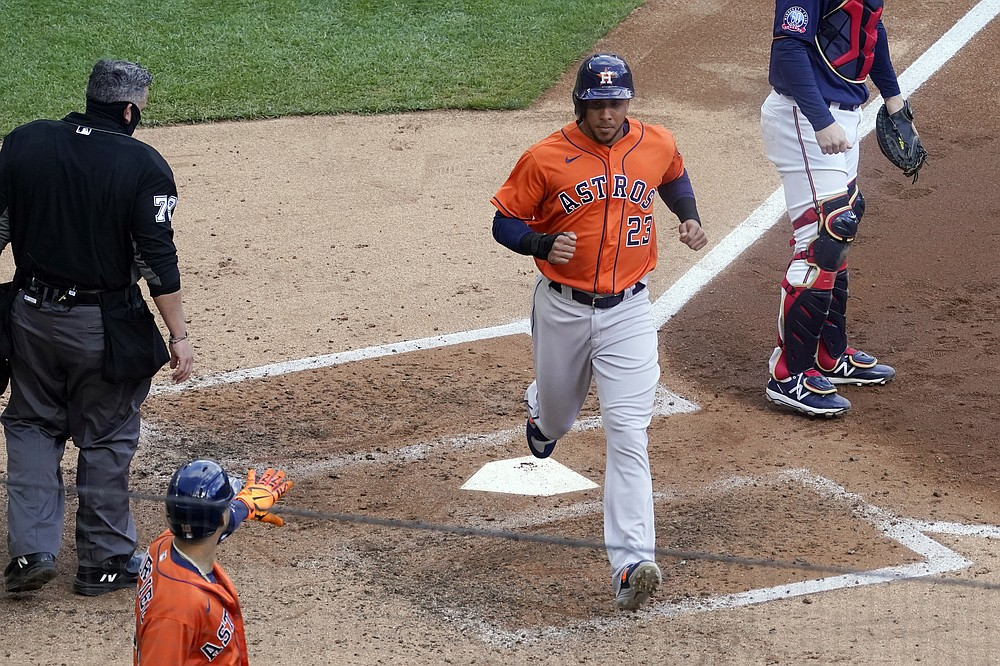 Houston Astros' Michael Brantley scores on a single by Kyle Tucker off Minnesota Twins pitcher Jose Berrios in the fourth inning of an American League wild-card series baseball game, Wednesday, Sept. 30, 2020, in Minneapolis. (AP Photo/Jim Mone)