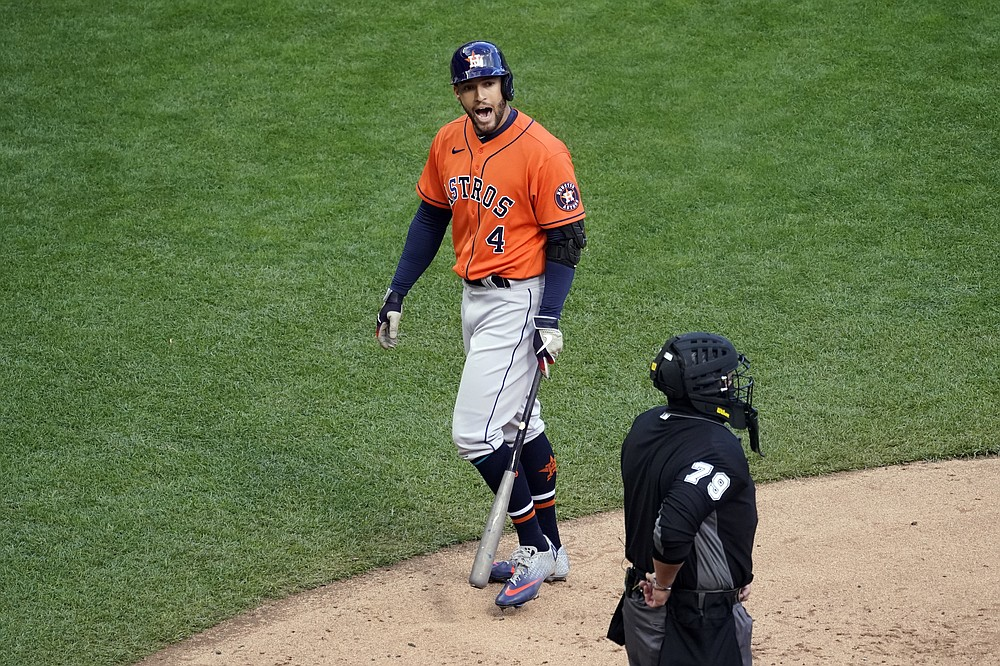 Houston Astros' George Springer, left, has some words with plate umpire Manny Gonzalez after a call strike in the fourth inning of an American League wild-card series baseball game against the Minnesota Twins, Wednesday, Sept. 30, 2020, in Minneapolis. (AP Photo/Jim Mone)