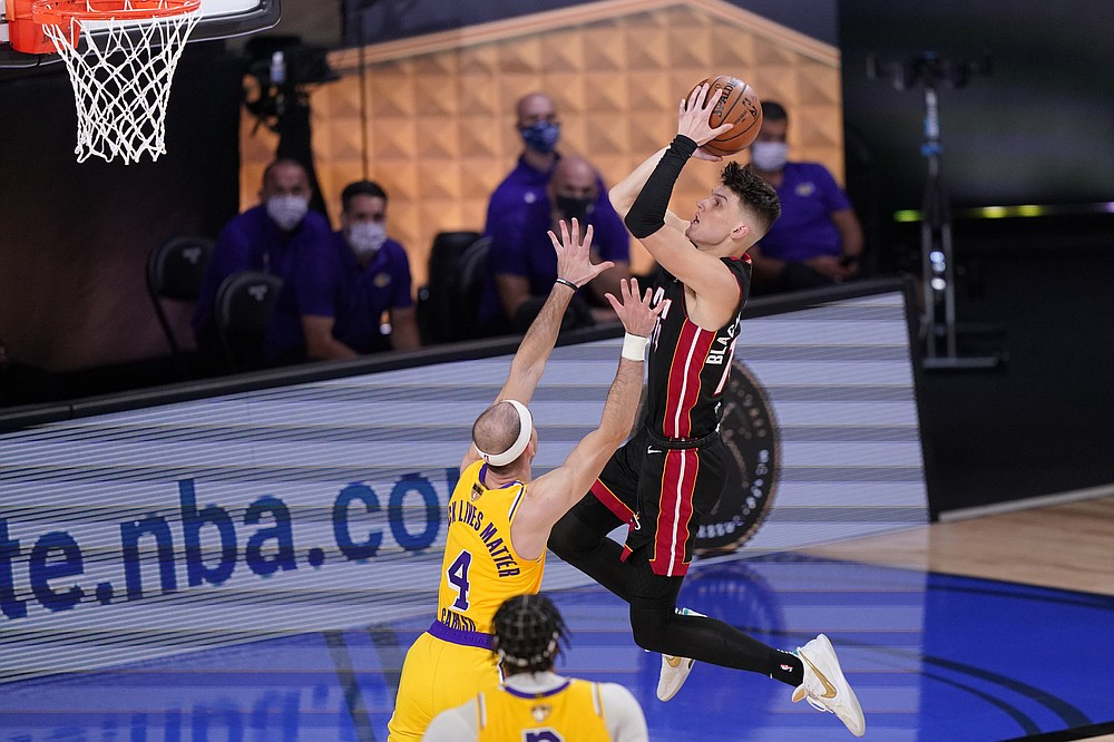 Miami Heat's Tyler Herro, right, drives to the basket against Los Angeles Lakers' Alex Caruso (4) during the second half of Game 1 of basketball's NBA Finals Wednesday, Sept. 30, 2020, in Lake Buena Vista, Fla. (AP Photo/Mark J. Terrill)