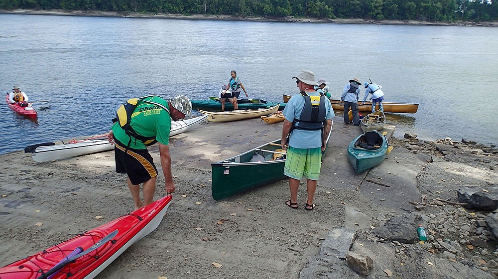 Paddlers, including Milan Rodgers (left) of Kansas City, Mo. and Jerry Phillips of Crestwood, Ky., launch boats to start their day on the river. (NWA Democrat-Gazette/Flip Putthoff)