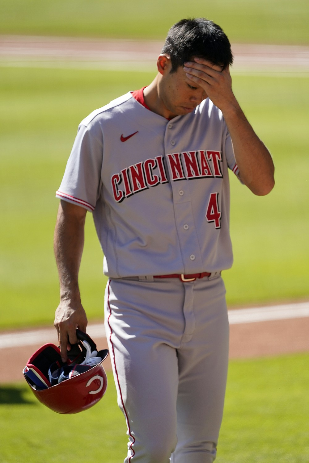 Cincinnati Reds' Shogo Akiyama of Japan, heads to the dugout after grounding out during the eighth inning against the Atlanta Braves in Game 2 of a National League wild-card baseball series, Thursday, Oct. 1, 2020, in Atlanta. (AP Photo/John Bazemore)