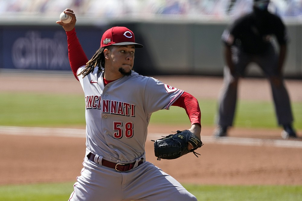 Cincinnati Reds starting pitcher Luis Castillo throws during the fifth inning in Game 2 of a National League wild-card baseball series against the Atlanta Braves, Thursday, Oct. 1, 2020, in Atlanta. (AP Photo/John Bazemore)