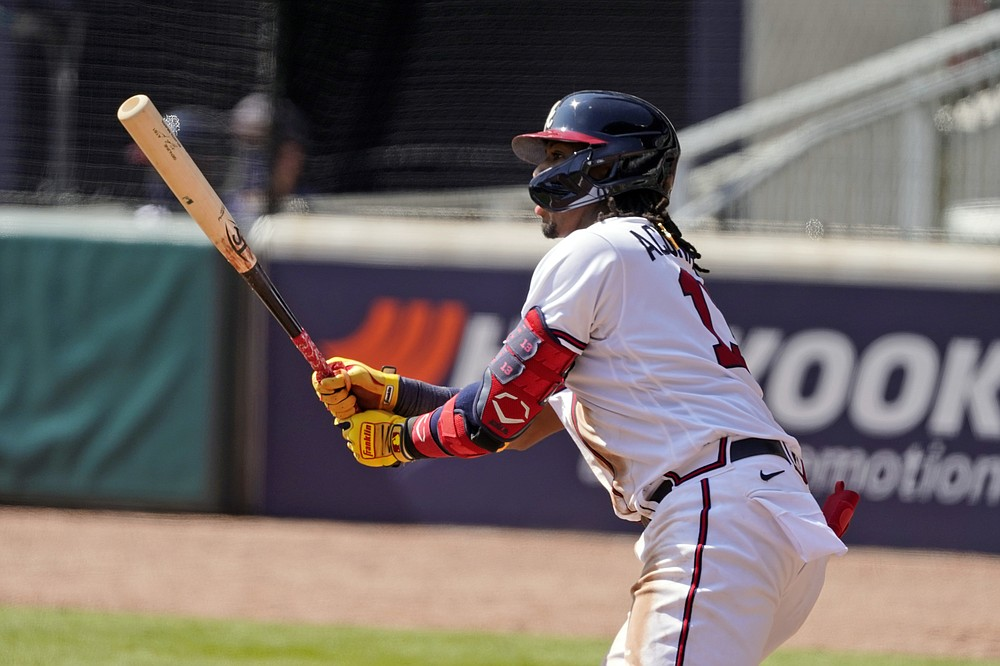 Atlanta Braves' Ronald Acuna Jr. hits an RBI double during the fifth inning against the Cincinnati Reds in Game 2 of a National League wild-card baseball series, Thursday, Oct. 1, 2020, in Atlanta. (AP Photo/John Bazemore)
