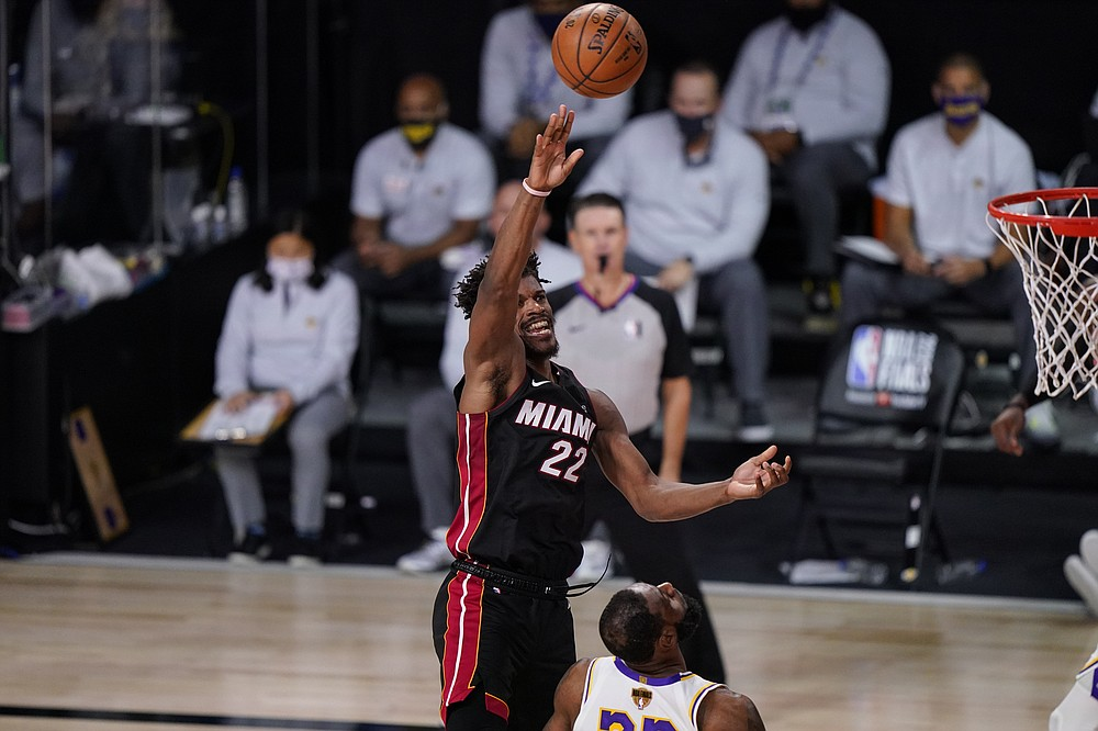 Miami Heat's Jimmy Butler (22) shoot the ball against the Los Angeles Lakers during the second half in Game 3 of basketball's NBA Finals, Sunday, Oct. 4, 2020, in Lake Buena Vista, Fla. (AP Photo/Mark J. Terrill)