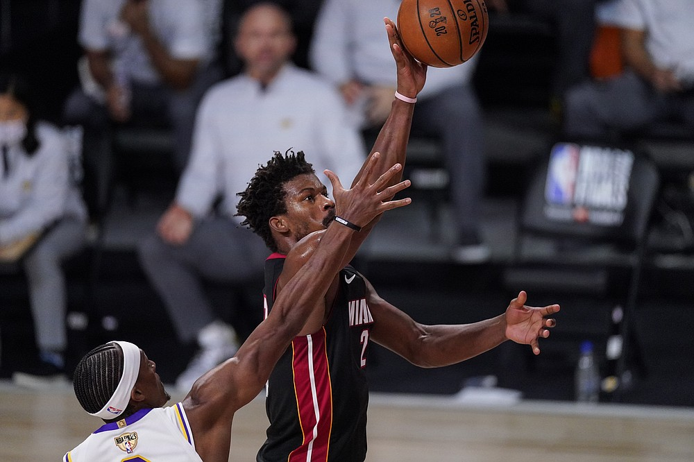 Miami Heat's Jimmy Butler (22) shoots the ball during the second half in Game 3 of basketball's NBA Finals against the Los Angeles Lakers, Sunday, Oct. 4, 2020, in Lake Buena Vista, Fla. (AP Photo/Mark J. Terrill)