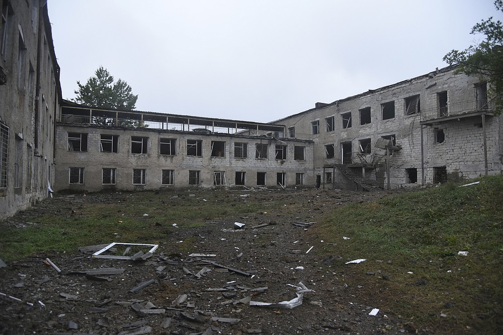 A view of school damaged after shelling by Azerbaijan's artillery during a military conflict in Stepanakert, self-proclaimed Republic of Nagorno-Karabakh, Azerbaijan, Monday, Oct. 5, 2020. Armenia accused Azerbaijan of firing missiles into the capital of the separatist territory of Nagorno-Karabakh, while Azerbaijan said several of its towns and its second-largest city were attacked. (David Ghahramanyan/NKR InfoCenter PAN Photo via AP)