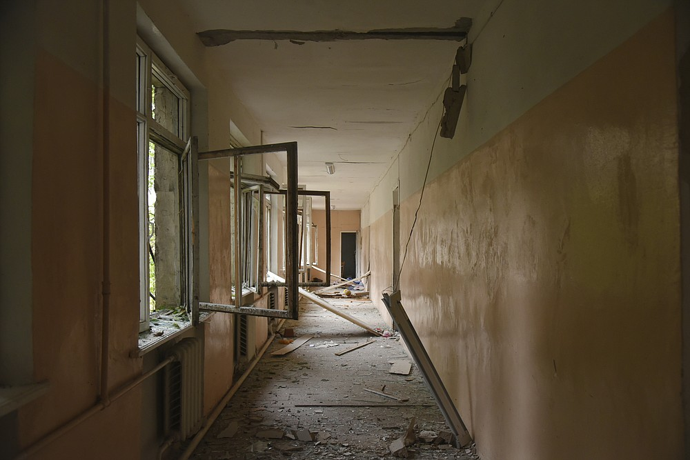 A view of the damage in a corridor of school after shelling by Azerbaijan's artillery during a military conflict in Stepanakert, self-proclaimed Republic of Nagorno-Karabakh, Azerbaijan, Monday, Oct. 5, 2020. Armenia accused Azerbaijan of firing missiles into the capital of the separatist territory of Nagorno-Karabakh, while Azerbaijan said several of its towns and its second-largest city were attacked. (David Ghahramanyan/NKR InfoCenter PAN Photo via AP)