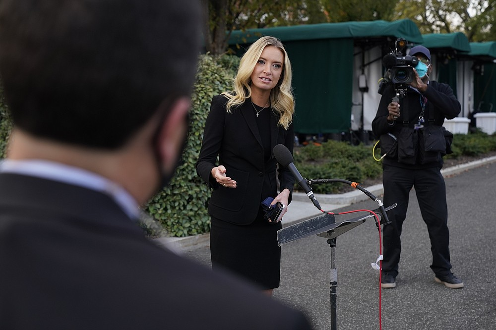 White House press secretary Kayleigh McEnany, talks to the media, Sunday, Oct. 4, 2020, outside the White House in Washington. (AP Photo/Jacquelyn Martin))