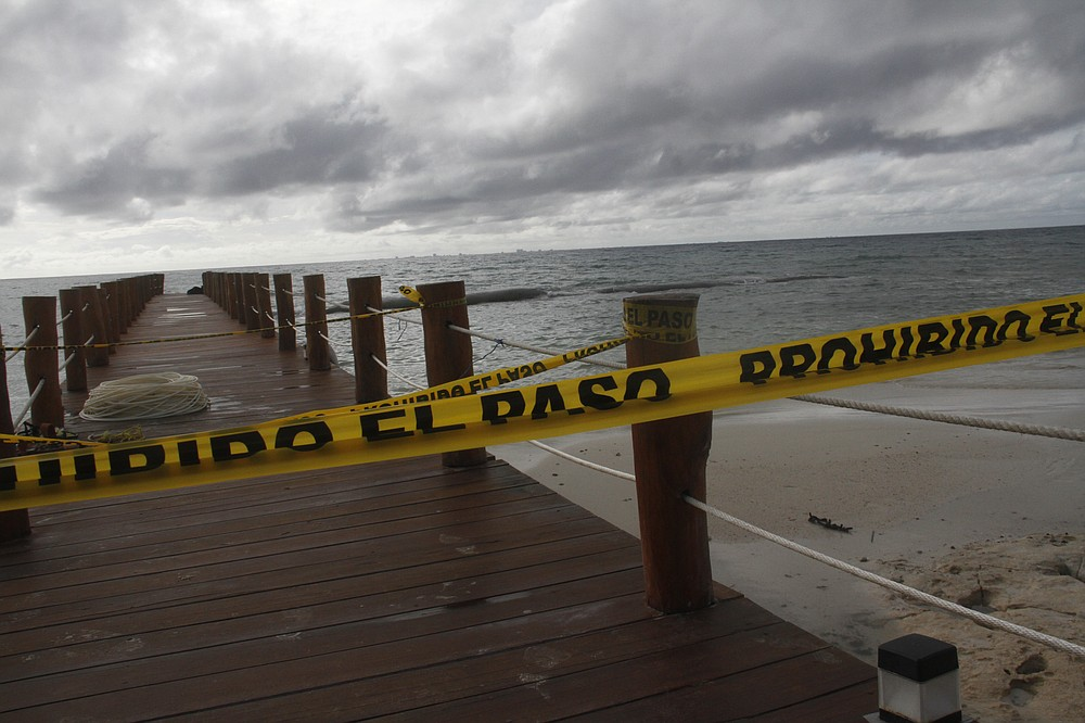 A dock is closed to the public before Hurricane Delta arrives near Playa del Carmen, Mexico, early Tuesday, Oct. 6, 2020. Hurricane Delta rapidly intensified into a Category 2 hurricane Tuesday on a course to hammer southeastern Mexico and then grow to a potentially catastrophic Category 4 on approach to the U.S. Gulf Coast this week. (AP Photo/Tomas Stargardter)