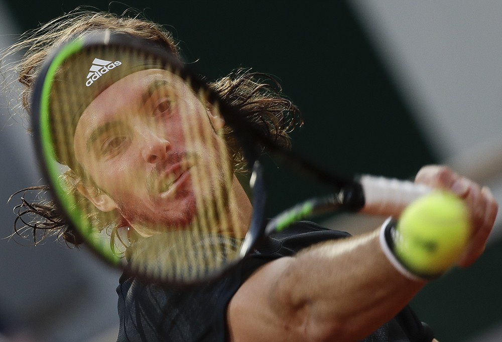 Greece's Stefanos Tsitsipas plays a shot against Russia's Andrey Rublev in the quarterfinal match of the French Open tennis tournament at the Roland Garros stadium in Paris, France, Wednesday, Oct. 7, 2020. (AP Photo/Alessandra Tarantino)