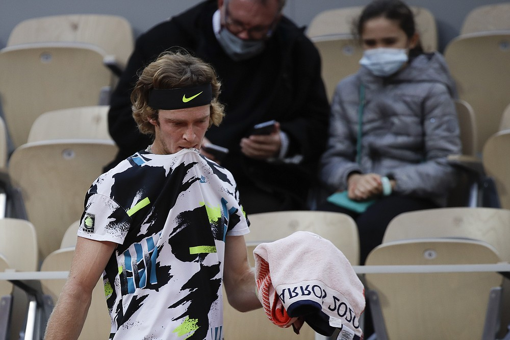 Russia's Andrey Rublev walks back to his bench after losing a game in the quarterfinal match of the French Open tennis tournament against Greece's Stefanos Tsitsipas at the Roland Garros stadium in Paris, France, Wednesday, Oct. 7, 2020. (AP Photo/Alessandra Tarantino)