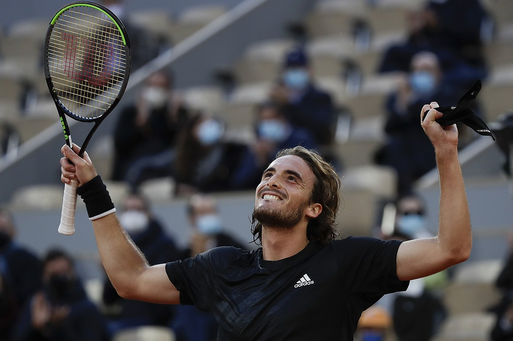 Greece's Stefanos Tsitsipas celebrates winning his quarterfinal match of the French Open tennis tournament against Russia's Andrey Rublev in three sets, 7-5, 6-2, 6-3, at the Roland Garros stadium in Paris, France, Wednesday, Oct. 7, 2020. (AP Photo/Alessandra Tarantino)
