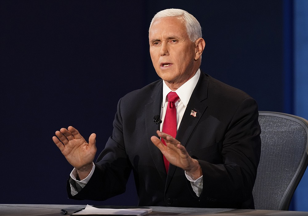 Vice President Mike Pence makes a point during the vice presidential debate with Democratic vice presidential candidate Sen. Kamala Harris, D-Calif., Wednesday, Oct. 7, 2020, at Kingsbury Hall on the campus of the University of Utah in Salt Lake City. (AP Photo/Patrick Semansky)