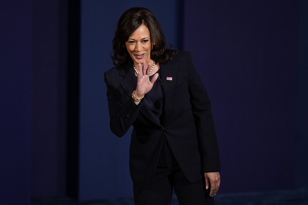 Democratic vice presidential candidate Sen. Kamala Harris, D-Calif., waves as she arrives on stage for the vice presidential debate with Vice President Mike Pence Wednesday, Oct. 7, 2020, at Kingsbury Hall on the campus of the University of Utah in Salt Lake City. (AP Photo/Julio Cortez)