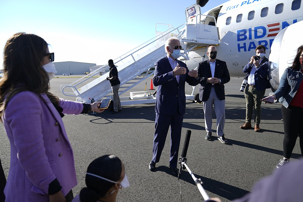Democratic presidential candidate former Vice President Joe Biden speaks to members of the media before boarding his campaign plane at New Castle Airport in New Castle, Del., Thursday, Oct. 8, 2020., en route to Arizona. (AP Photo/Carolyn Kaster)