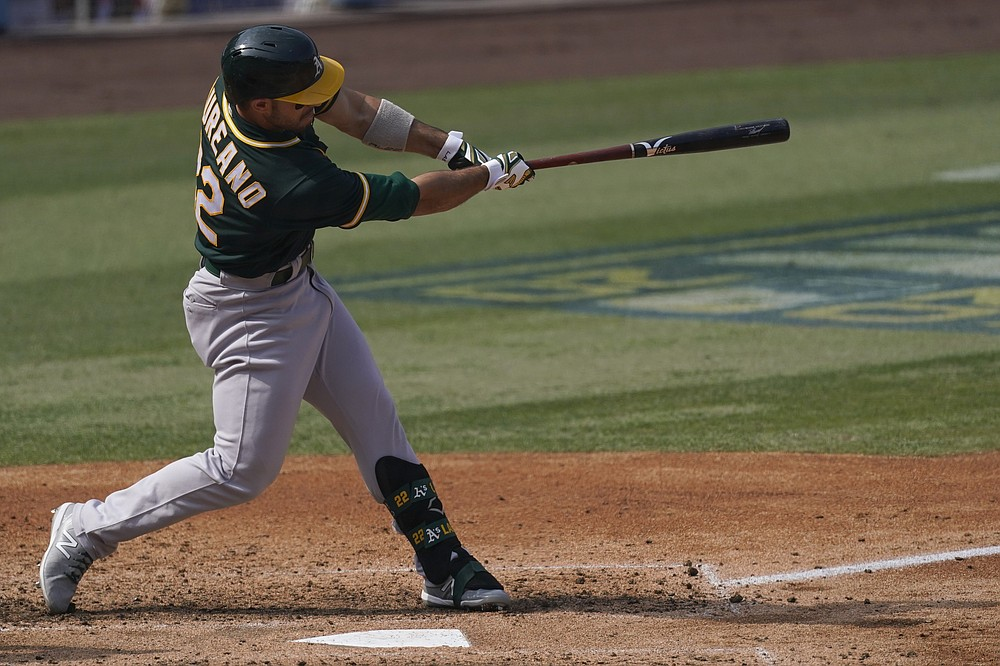 Oakland Athletics' Ramon Laureano hits a solo home run against the Houston Astros during the fifth inning of Game 4 of a baseball American League Division Series in Los Angeles, Thursday, Oct. 8, 2020. (AP Photo/Ashley Landis)