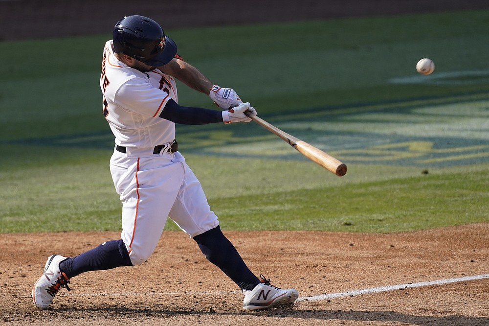 Houston Astros' Jose Altuve hits a two-run home run against the Oakland Athletics during the seventh inning of Game 4 of a baseball American League Division Series in Los Angeles, Thursday, Oct. 8, 2020. (AP Photo/Ashley Landis)