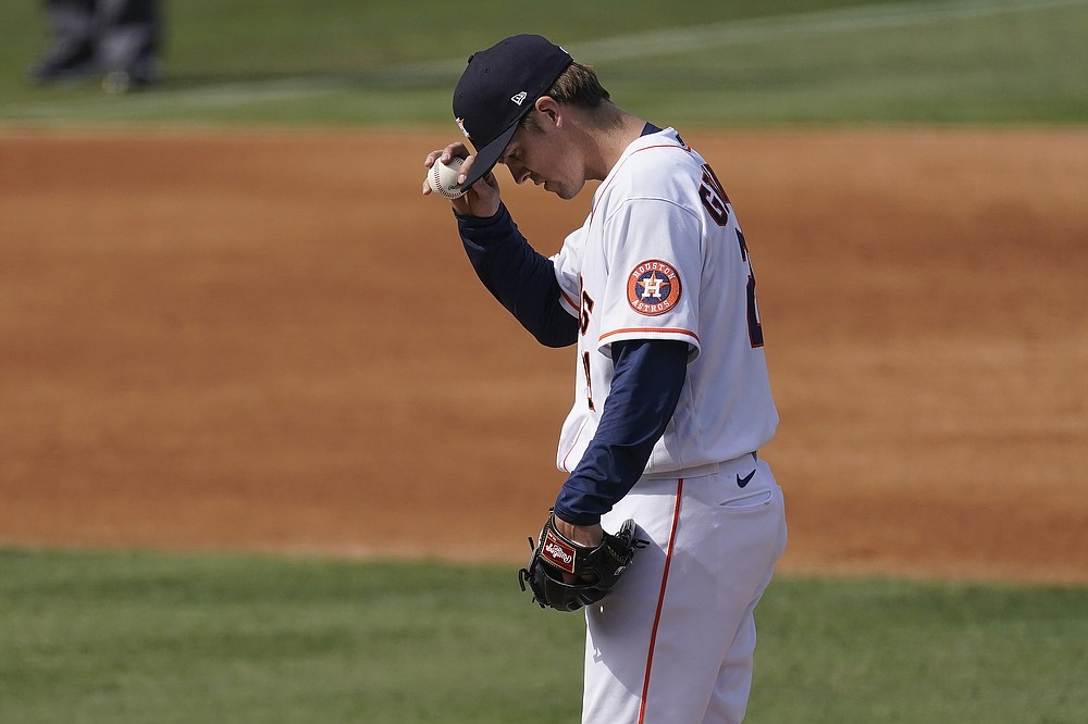 Houston Astros pitcher Zack Greinke grabs his cap on the mound during the fifth inning of Game 4 of a baseball American League Division Series against the Oakland Athletics in Los Angeles, Thursday, Oct. 8, 2020. (AP Photo/Ashley Landis)
