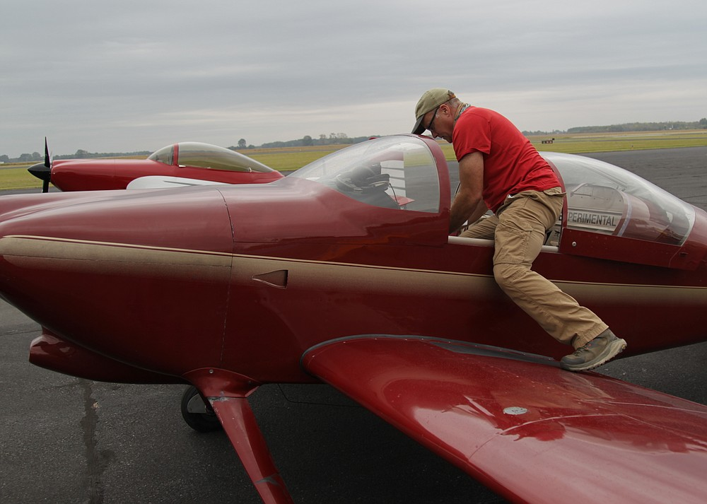 Abe Gaskin of Gallatin, Tenn., climbs from the cockpit of his RV-7 experimental aircraft following a morning formation flight Friday. Gallatin said he purchased the aircraft seven years ago already built from the previous owner. (Pine Bluff Commercial/Dale Ellis)