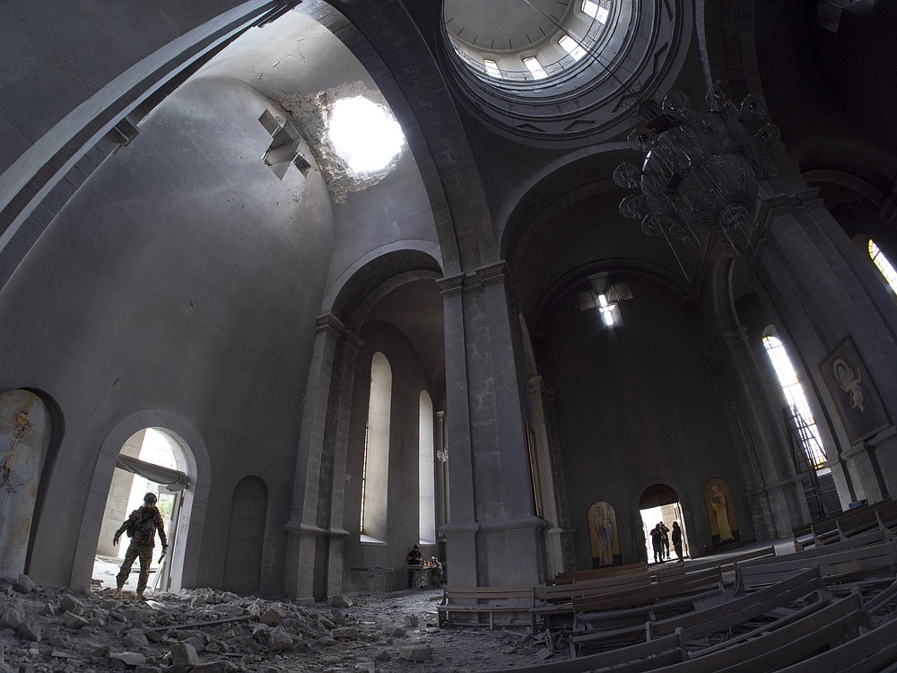 A hole made by shell in the roof of the Holy Savior Cathedral during a military conflict, in Shushi, outside Stepanakert, self-proclaimed Republic of Nagorno-Karabakh, Thursday, Oct. 8, 2020. Armenia accused Azerbaijan of firing missiles into the capital of the separatist territory of Nagorno-Karabakh, while Azerbaijan said several of its towns and its second-largest city were attacked. (AP Photo)