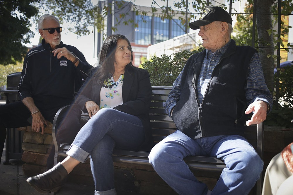 Danny Russell, Reyna Maloy and Albert King recall memories, Friday, October 2, 2020 at the Fayetteville Square in Fayetteville. Check out nwaonline.com/2010010Daily/ for today's photo gallery.  (NWA Democrat-Gazette/Charlie Kaijo)