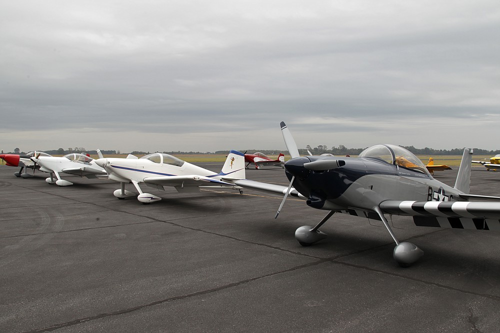 """RV experimental aircraft parked in formation at Grider Field Friday during the weekend formation flight clinic sponsored by the Bulldog Formation Flight Team, headed by Gerald """"Bulldog"""" Lloyd, who has been flying his own RV-4 airplane since he completed building it as a family project in 1991. (Pine Bluff Commercial/Dale Ellis)"""