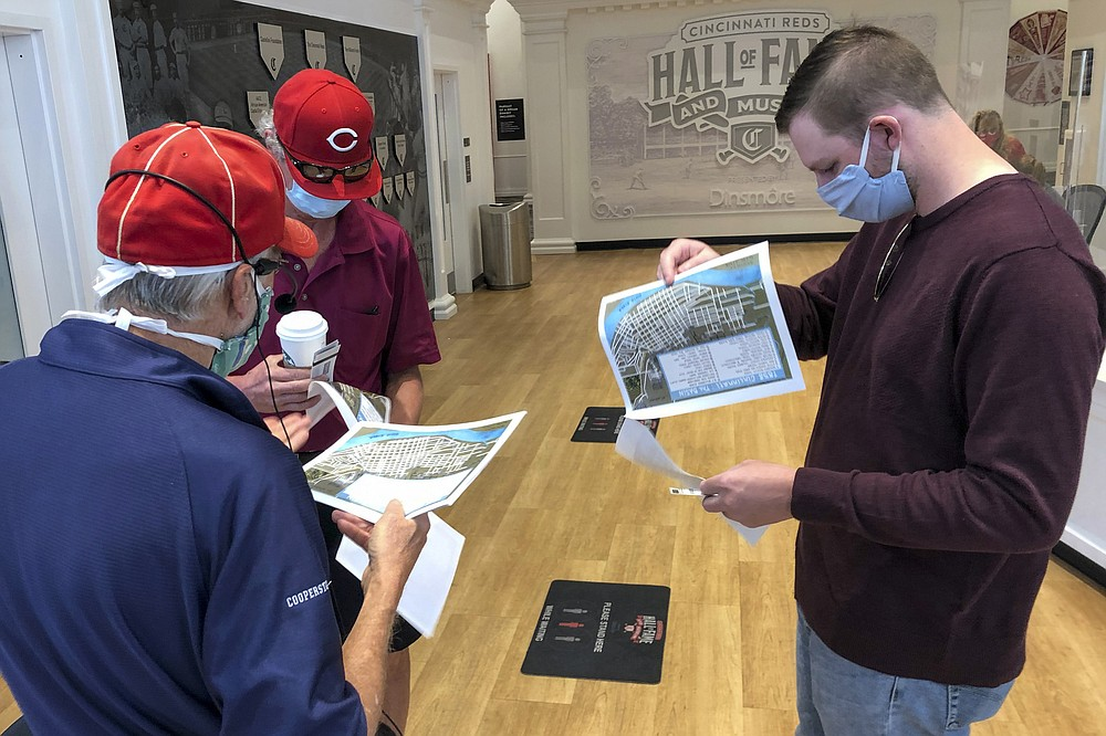 Researcher and tour guide Larry Phillips, left, talks with Bob Doherty, center, and his son Mack Doherty before a