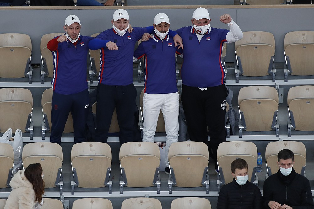 Fans of Serbia's Novak Djokovic appear to have forgotten about social distancing rules in the final match of the French Open tennis tournament against Spain's Rafael Nadal at the Roland Garros stadium in Paris, France, Sunday, Oct. 11, 2020. (AP Photo/Alessandra Tarantino)
