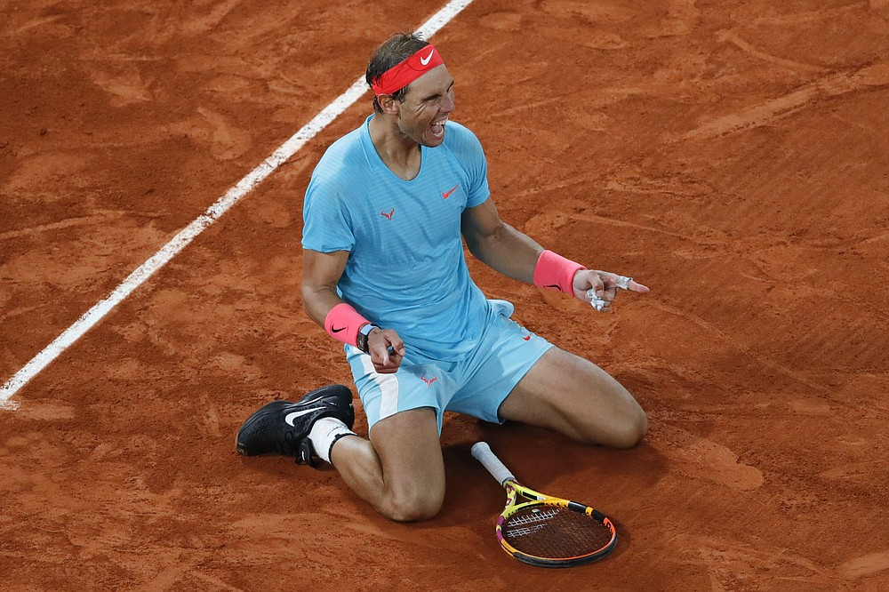 Spain's Rafael Nadal celebrates winning the final match of the French Open tennis tournament against Serbia's Novak Djokovic in three sets, 6-0, 6-2, 7-5, at the Roland Garros stadium in Paris, France, Sunday, Oct. 11, 2020. (AP Photo/Christophe Ena)