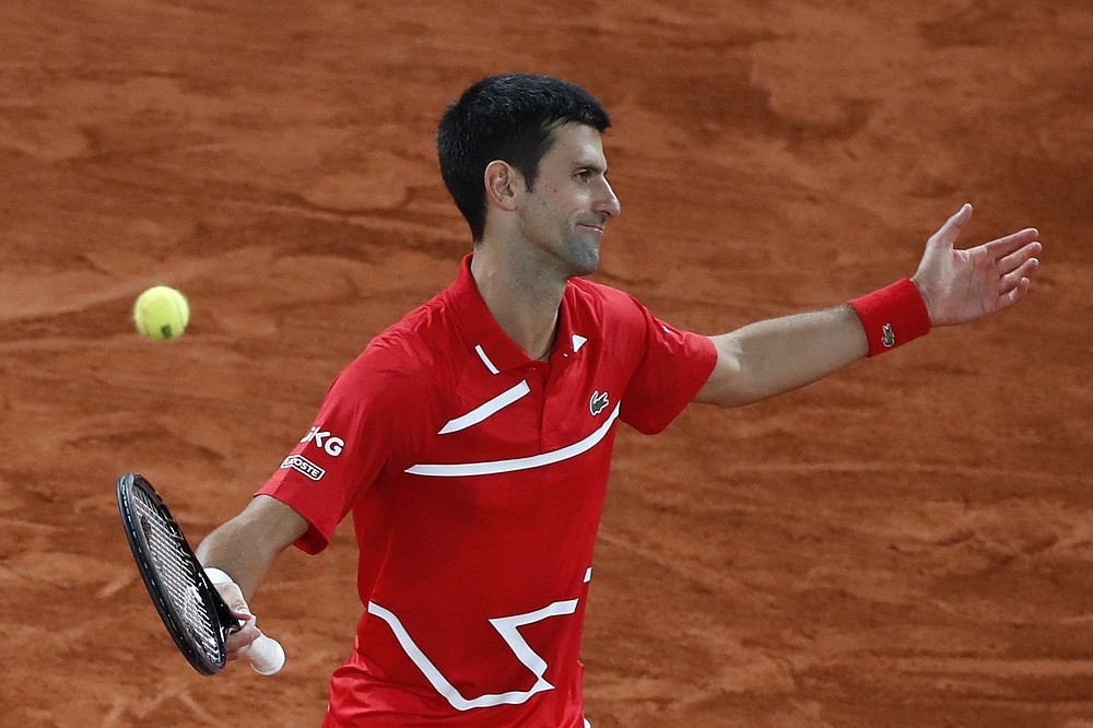 Serbia's Novak Djokovic reacts after missing a shot against Spain's Rafael Nadal in the final match of the French Open tennis tournament at the Roland Garros stadium in Paris, France, Sunday, Oct. 11, 2020. (AP Photo/Alessandra Tarantino)