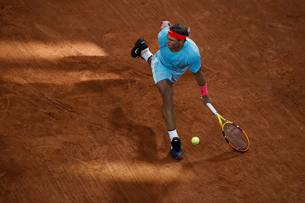 Spain's Rafael Nadal plays a shot against Serbia's Novak Djokovic in the final match of the French Open tennis tournament at the Roland Garros stadium in Paris, France, Sunday, Oct. 11, 2020. (AP Photo/Alessandra Tarantino)