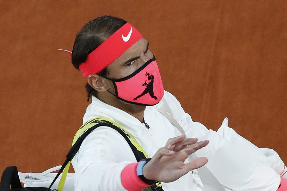 Spain's Rafael Nadal wears a face mask as he walks onto the court for the final match of the French Open tennis tournament against Serbia's Novak Djokovic at the Roland Garros stadium in Paris, France, Sunday, Oct. 11, 2020. (AP Photo/Alessandra Tarantino)
