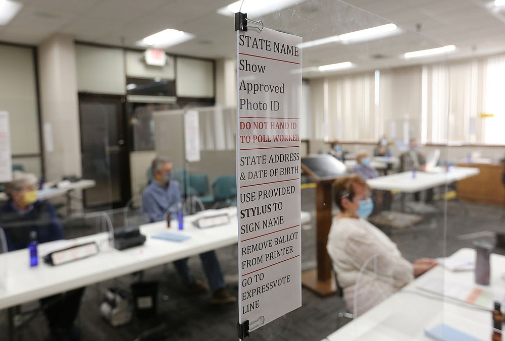 Signage is posted on plexiglass Tuesday, October 6, 2020, as Washington County poll workers participate in procedural and safety protocol training for early voting and the November 3 general election Tuesday, October 6, 2020 led by Jennifer Price, Director of Elections with the Washington County Election Commission, at the Washington County Court House in Fayetteville. Check out nwadg.com/photos for a photo gallery.(NWA Democrat-Gazette/David Gottschalk)